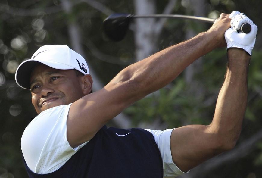En la imagen un registro del golfista estadounidense Tiger Woods, quien competirá por decimoséptima vez en el The Players Championship,torneo que ganó en 2001 y 2013. EFE/Archivo