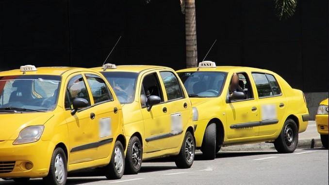 Taxis, taxistas.